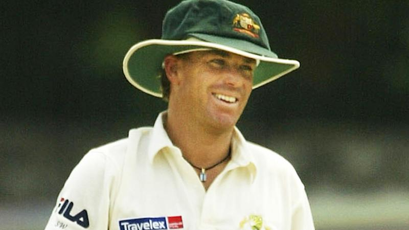 Shane Warne is pictured wearing his baggy green cap during a Test match in 2004.