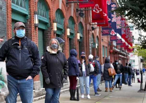 PHOTO: Hundreds stand in line to vote at Fenway Park in Boston, Oct. 17, 2020. (John Tlumacki/The Boston Globe via Getty Images)