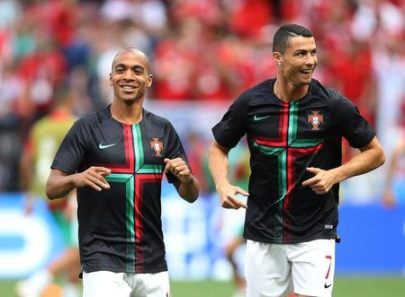 Soccer Football - World Cup - Group B - Portugal vs Morocco - Luzhniki Stadium, Moscow, Russia - June 20, 2018 Portugal's Joao Mario and Cristiano Ronaldo during the warm up before the match REUTERS/Carl Recine
