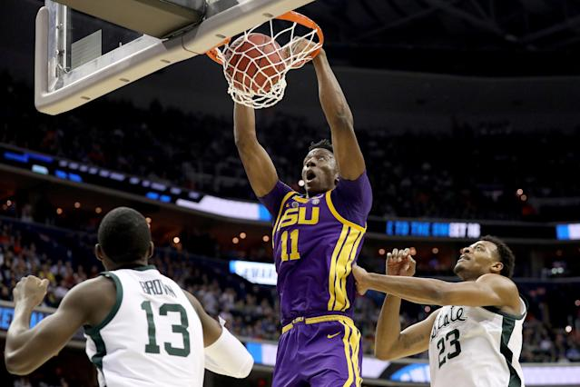 <p>Kavell Bigby-Williams #11 of the LSU Tigers dunks the ball against Gabe Brown #13 and Xavier Tillman #23 of the Michigan State Spartans during the second half in the East Regional game of the 2019 NCAA Men's Basketball Tournament at Capital One Arena on March 29, 2019 in Washington, DC. (Photo by Patrick Smith/Getty Images) </p>