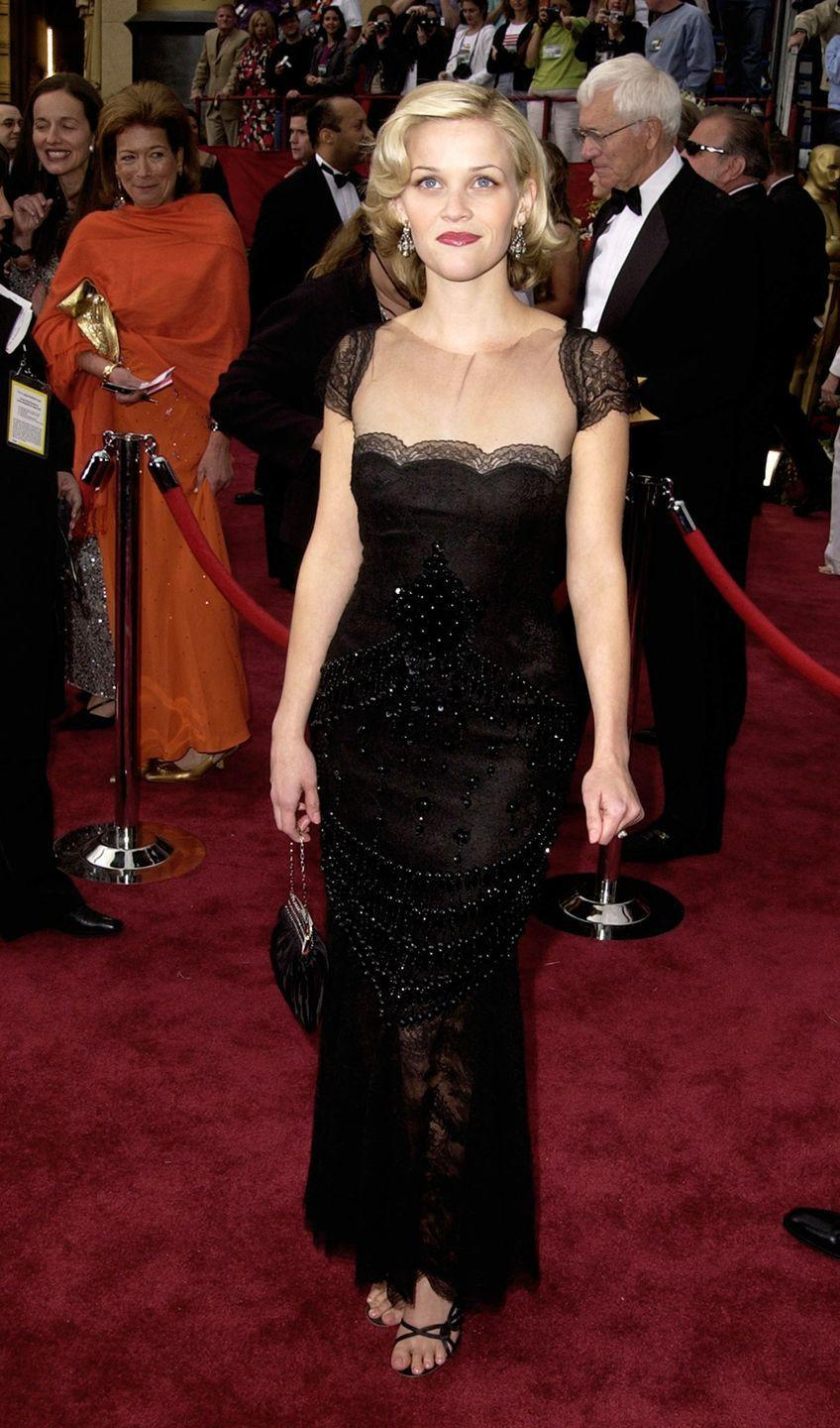 <p>Witherspoon made quite the stunning Oscars debut in 2002 in a sultry lace Valentino gown. </p>