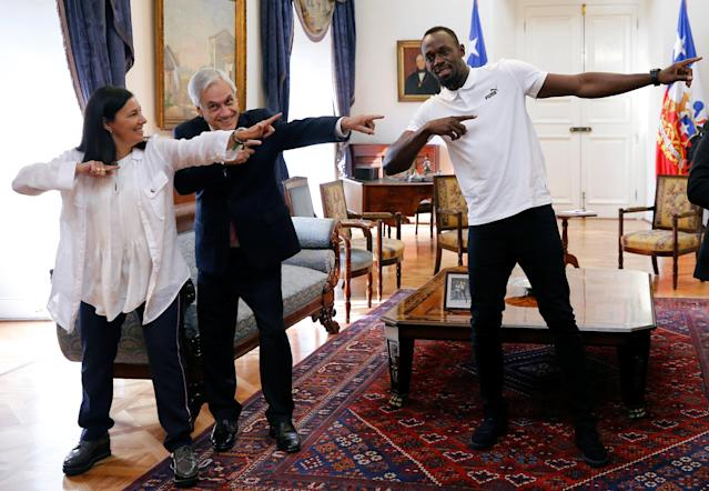 Chilean President Sebastian Pinera and the former sprinter Usain Bolt gesture during his visit at the government palace in Santiago, Chile April 1, 2019. REUTERS/Rodrigo Garrido
