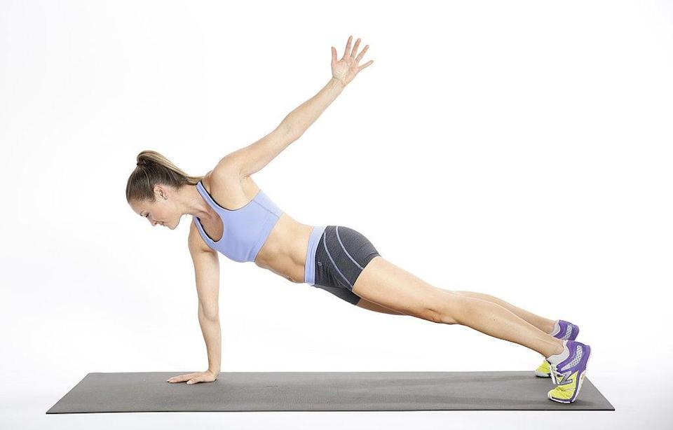 <ul> <li>In a plank position, reach your left arm back and then circle it overhead, bringing your palm back to the floor; repeat on the other side to complete the rep.</li> <li>The wider your feet are, the more stable you will be. Do not let your pelvis drift toward the ceiling. </li> </ul>