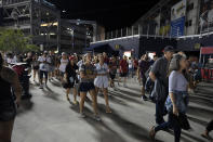Spectators leave the stadium after an incident near the ballpark during the sixth inning of a baseball game between the Washington Nationals and the San Diego Padres, Saturday, July 17, 2021, in Washington. (AP Photo/Nick Wass)
