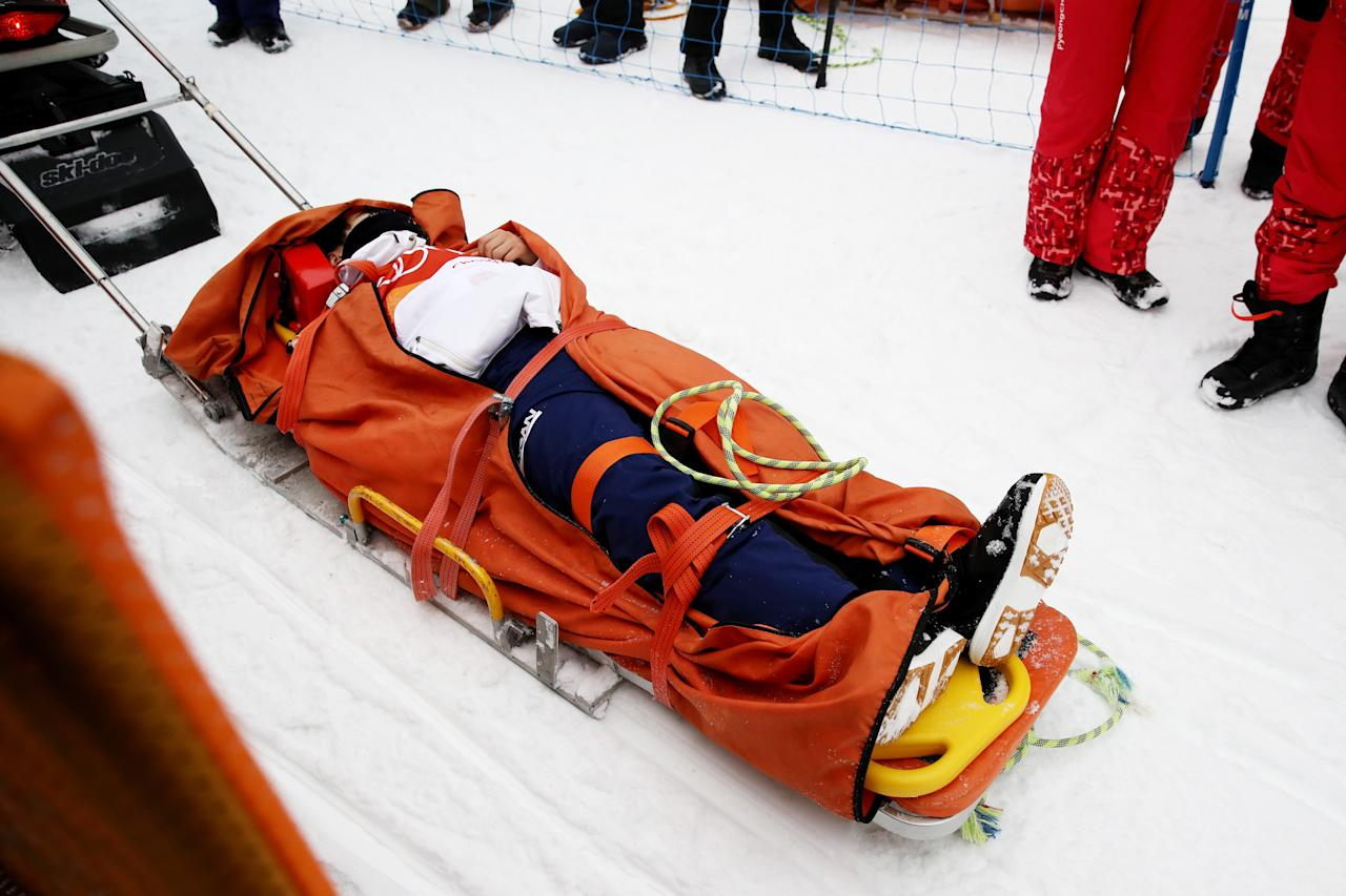 <p>Yuto Totsuka of Japan is stretched off by medical staff after crashing in the during the Snowboard Men's Halfpipe Final on day five of the PyeongChang 2018 Winter Olympics at Phoenix Snow Park on February 14, 2018 in Pyeongchang-gun, South Korea. (Photo by Cameron Spencer/Getty Images) </p>