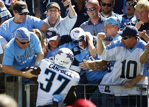 Tennessee Titans' Tommie Campbell celebrates with fans after scoring a touchdown on a 65-yard punt return against the Detroit Lions in the first quarter of an NFL football game, Sunday, Sept. 23, 2012, in Nashville, Tenn. (AP Photo/Joe Howell)