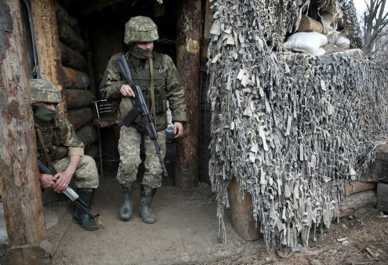 Ukrainian servicemen wait at a position on the frontline with Russia-backed separatists near Gorlivka, Donetsk region