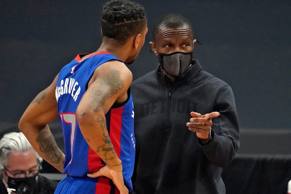 Pistons coach Dwane Casey talks to guard Rodney McGruder during the first half in Tampa, Florida, on Wednesday, March 3, 2021.