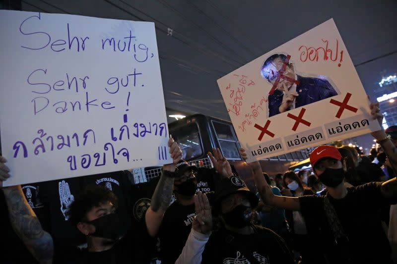 Pro-democracy protesters hold banners near German Embassy in Bangkok