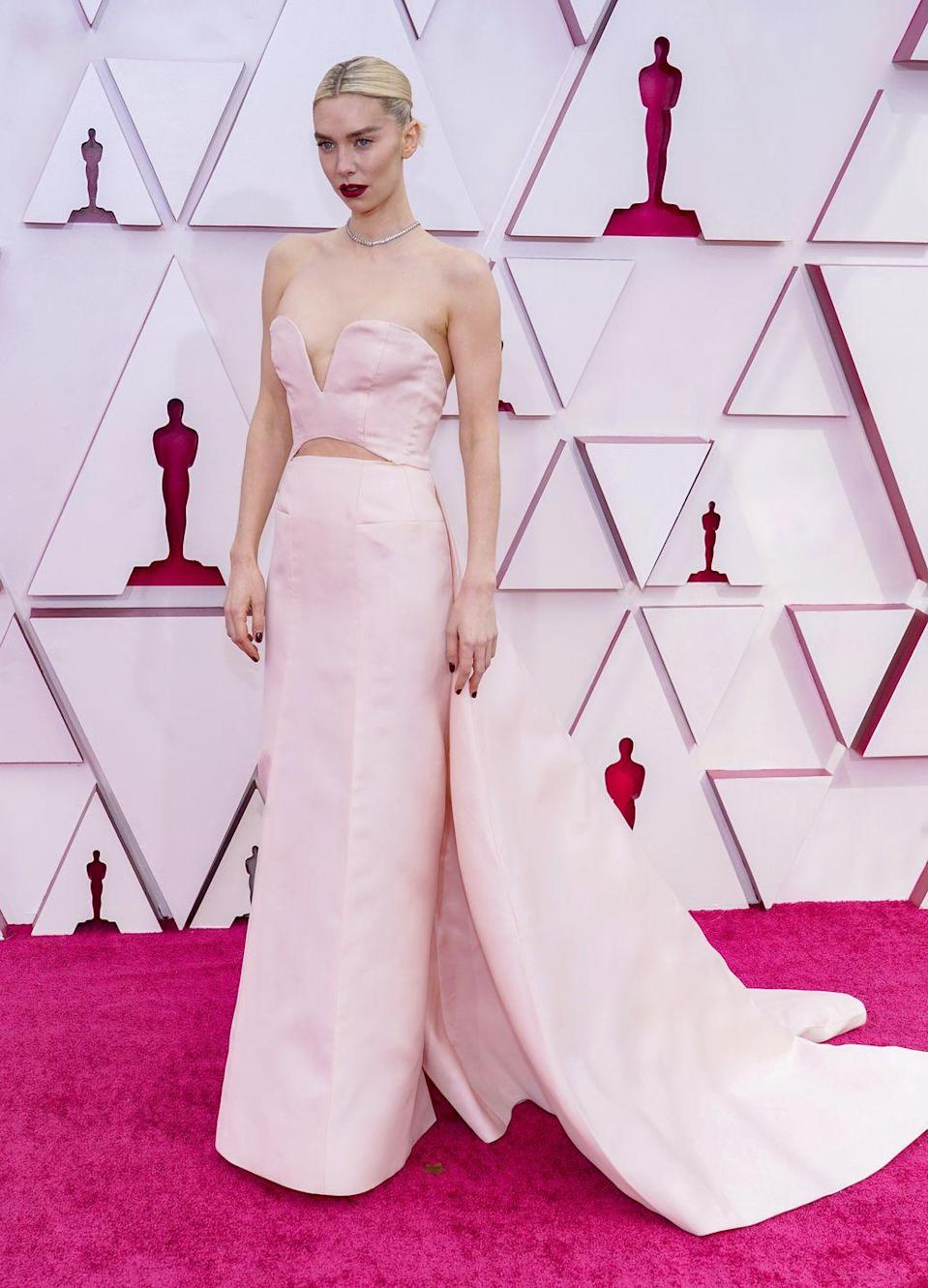 <p>Strapless gowns with cut-out panels were the big trend of the night, with British actress Vanessa Kirby also choosing one in the form of this pale pink Gucci number. Kirby looked beautiful in the dress, which featured a bodice, a column skirt and a long dramatic chain. She paired it with a dark lip, a slicked-back bun and a choker necklace by Cartier.</p>