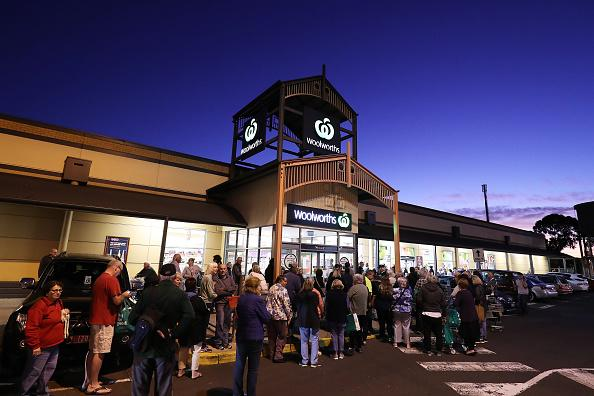 General view outside a Woolworths in Sunbury as people wait outside during sunrise.