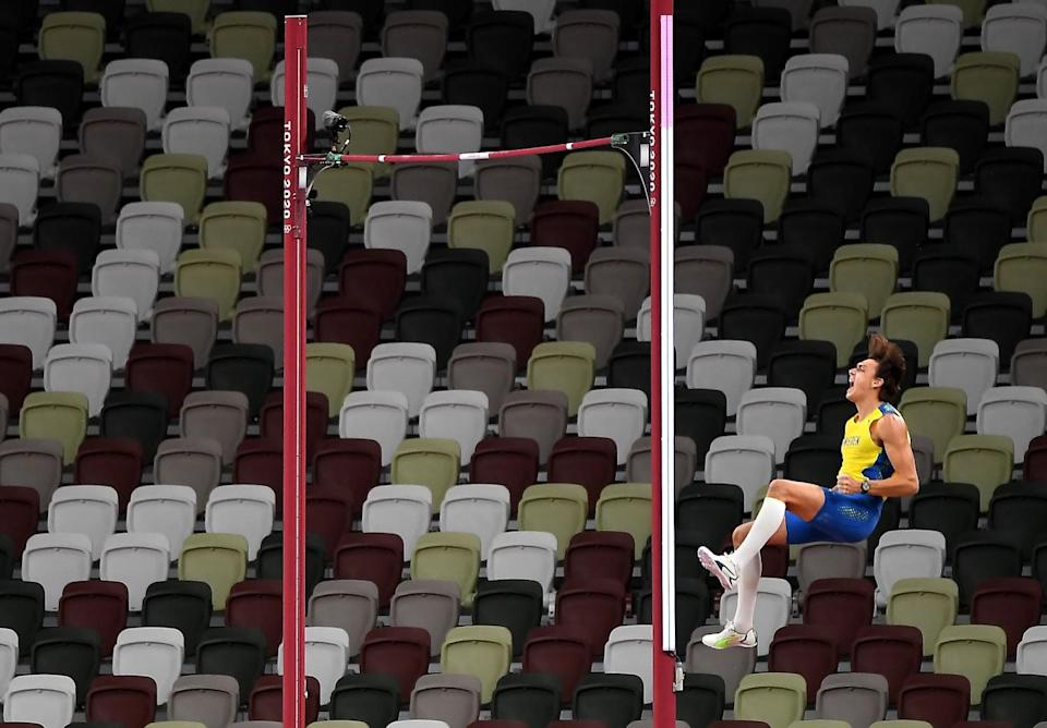 -Sweden's Armand Duplantis celebrates after clearing the bar to win the gold medal in the pole vault.