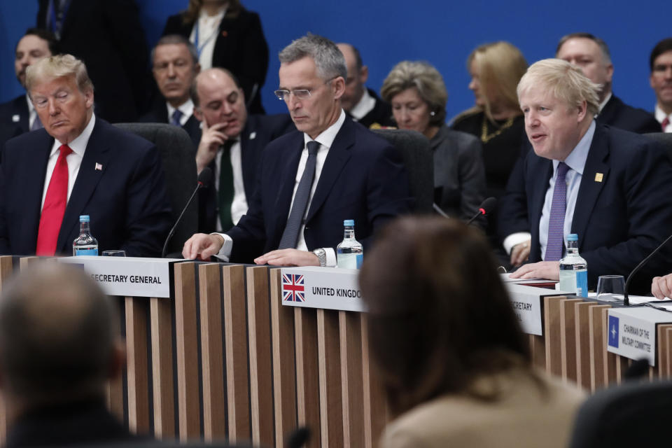 U.S. President Donald Trump, left, and NATO Secretary General Jens Stoltenberg, center, listen to British Prime Minister Boris Johnson, right, during a NATO round table meeting at The Grove hotel and resort in Watford, Hertfordshire, England, Wednesday, Dec. 4, 2019. As NATO leaders meet and show that the world's biggest security alliance is adapting to modern threats, NATO Secretary-General Jens Stoltenberg is refusing to concede that the future of the 29-member alliance is under a cloud. (AP Photo/Frank Augstein)