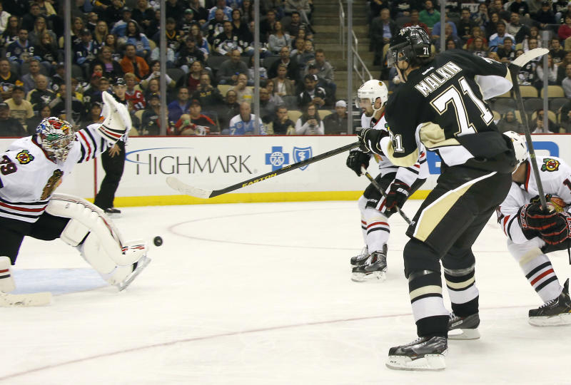 Pittsburgh Penguins' Evgeni Malkin (71), of Russia, has his shot stopped by Chicago Blackhawks goalie Nikolai Khabibulin (39), of Russia, in the second period of an NHL preseason hockey game on Monday, Sept. 23, 2013, in Pittsburgh. (AP Photo/Keith Srakocic)