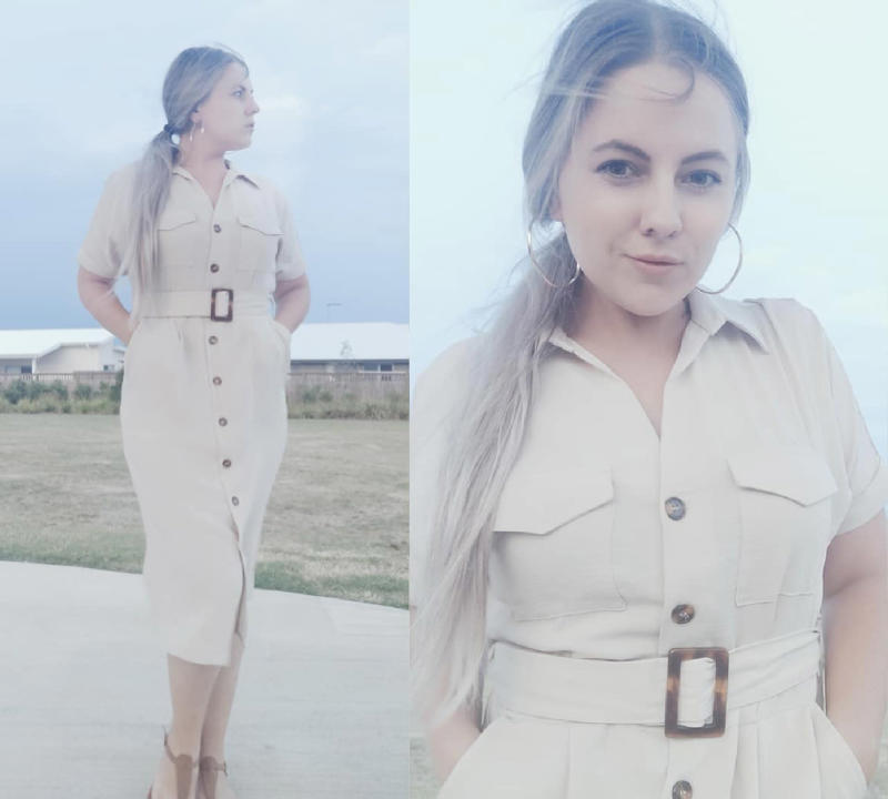 Woman poses in cream Kmart dress