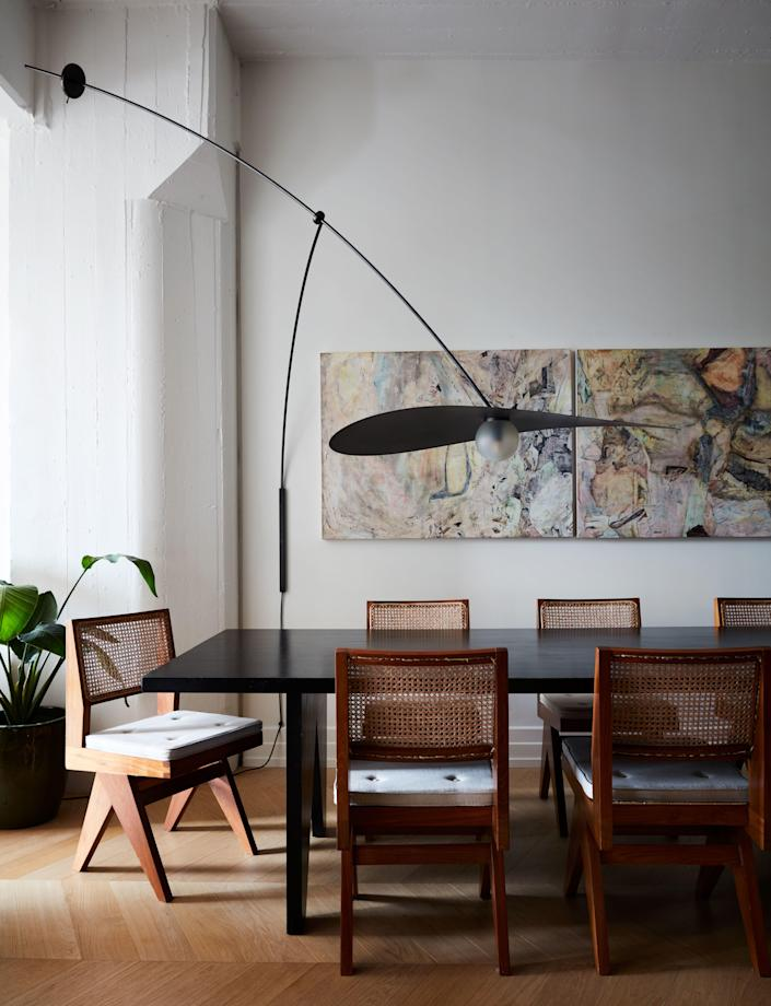 Valle designed the maple dining table and, with Ladies & Gentlemen Studio, the wall-mounted mobile lamp. The painting is by Christopher Astley.