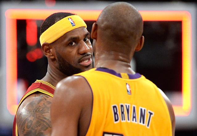 LeBron James will almost certainly pass Kobe Bryant on the all-time scoring list this season. (Getty Images)