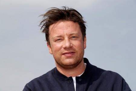 Chef Jamie Oliver poses during a photocall at the annual MIPCOM television programme market in Cannes