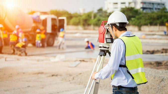 civil engineer surveying a construction site