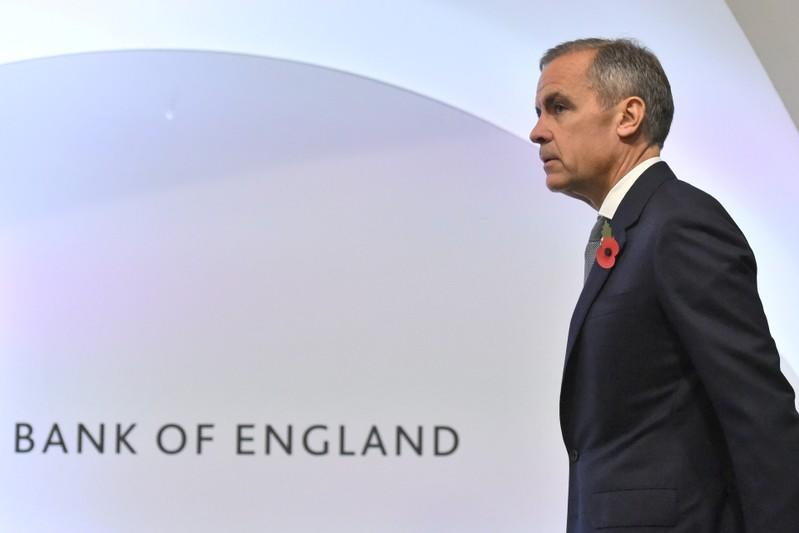 FILE PHOTO: Bank of England Governor Mark Carney attends a Bank of England news conference, in the City of London