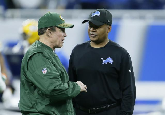 Packers defensive coordinator Dom Capers, left, talks with Lions coach Jim Caldwell before a Week 17 game. Both men were fired after the game. (AP)