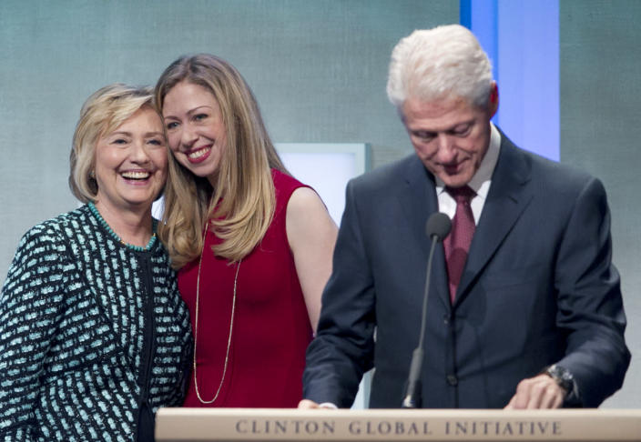 <p>Former President Bill Clinton prepares to address the Clinton Global Initiative with his wife, Hillary Rodham Clinton, and daughter, Chelsea, onstage in September 2013 in New York. (Photo: Mark Lennihan/AP)</p>