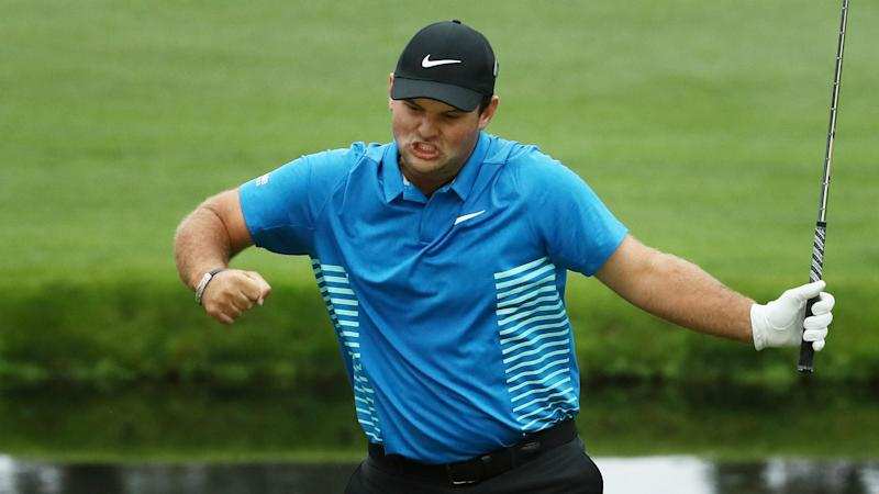 Reed wins first major at the Masters
