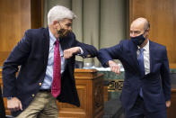 "Sen. Bill Cassidy, R-La., left, elbow bumps Labor Secretary Eugene Scalia before a Senate Finance Committee hearing on ""COVID-19/Unemployment Insurance"" on Capitol Hill in Washington on Tuesday, June 9, 2020. (Caroline Brehman/CQ Roll Call/Pool via AP)"