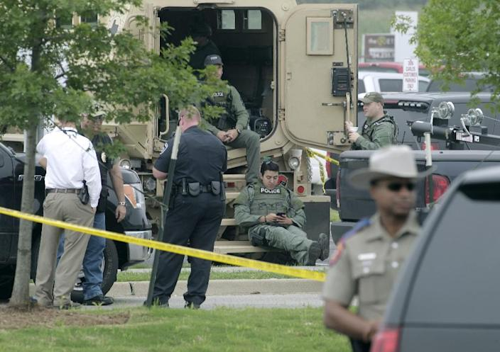 Authorities said they are still piecing together the events that led up to a motorcyle gang shootout at the Twin Peaks Sports Bar and Grillthe Twin Peaks restaurant in Waco, Texas that left nine people dead (AFP Photo/Erich Schlegel)