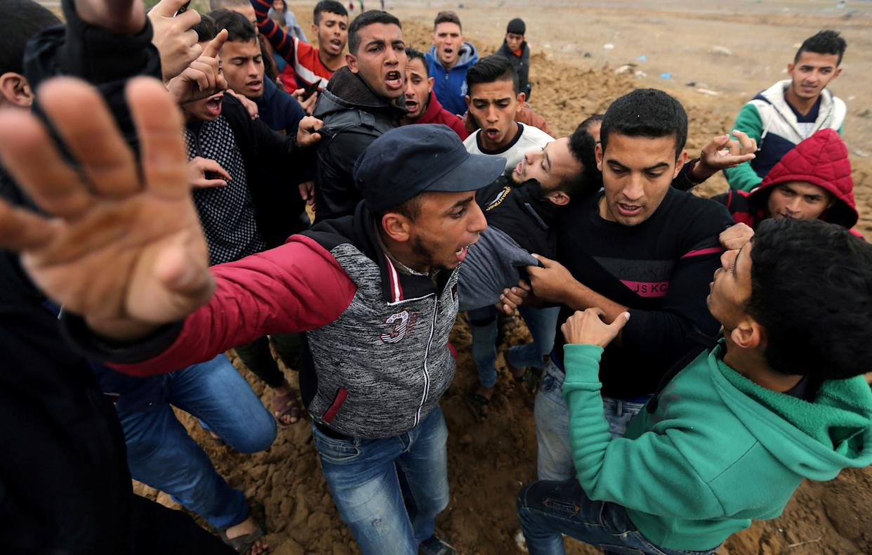 A wounded Palestinian protester is evacuated during clashes with Israeli troops at a protest near the border with Israel in the southern Gaza Strip December 7, 2017.