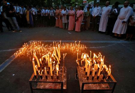 FILE PHOTO:  People attend a prayer meeting after lighting candles to show solidarity with the victims of Sri Lanka's serial bomb blasts, outside a church in Kolkata, India, April 23, 2019. REUTERS/Rupak De Chowdhuri