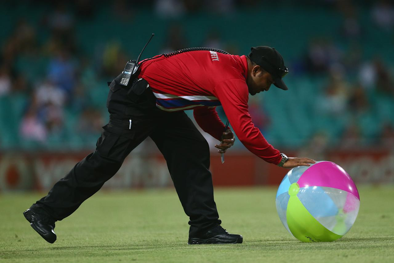 SYDNEY, AUSTRALIA - FEBRUARY 08:  A crowd safety worker collects a beachball from the field during game four of the Commonwealth Bank One Day International Series between Australia and the West Indies at Sydney Cricket Ground on February 8, 2013 in Sydney, Australia.  (Photo by Mark Kolbe/Getty Images)