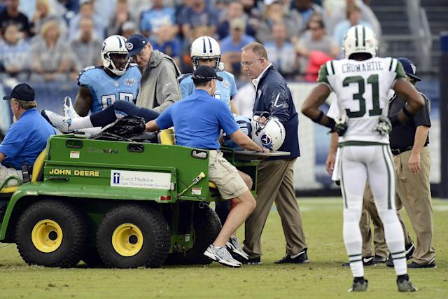New York Jets cornerback Antonio Cromartie (31) watches as Tennessee Titans quarterback Jake Locker (10) is taken off the field after being injured in the third quarter of an NFL football game against the New York Jets on Sunday, Sept. 29, 2013, in Nashville, Tenn. (AP Photo/Mark Zaleski)
