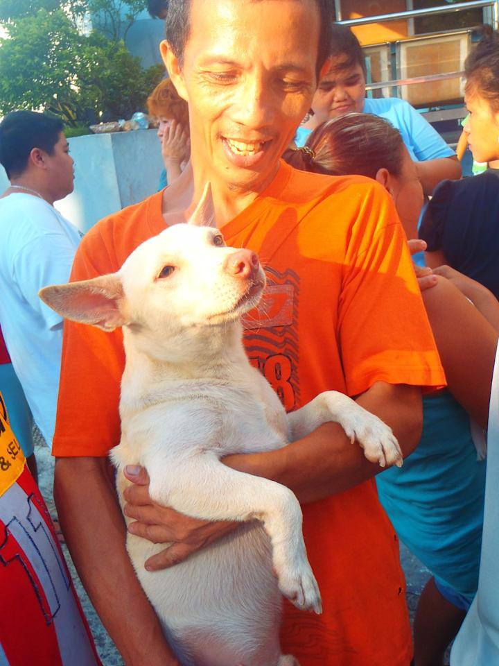 A pet owner from Malabon and his dog were among the receipients of  relief from the PAWS team