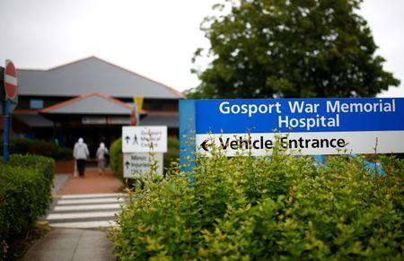 A man and a woman enter Gosport War Memorial Hospital in Gosport, Britain, June 20, 2018. REUTERS/Henry Nicholls