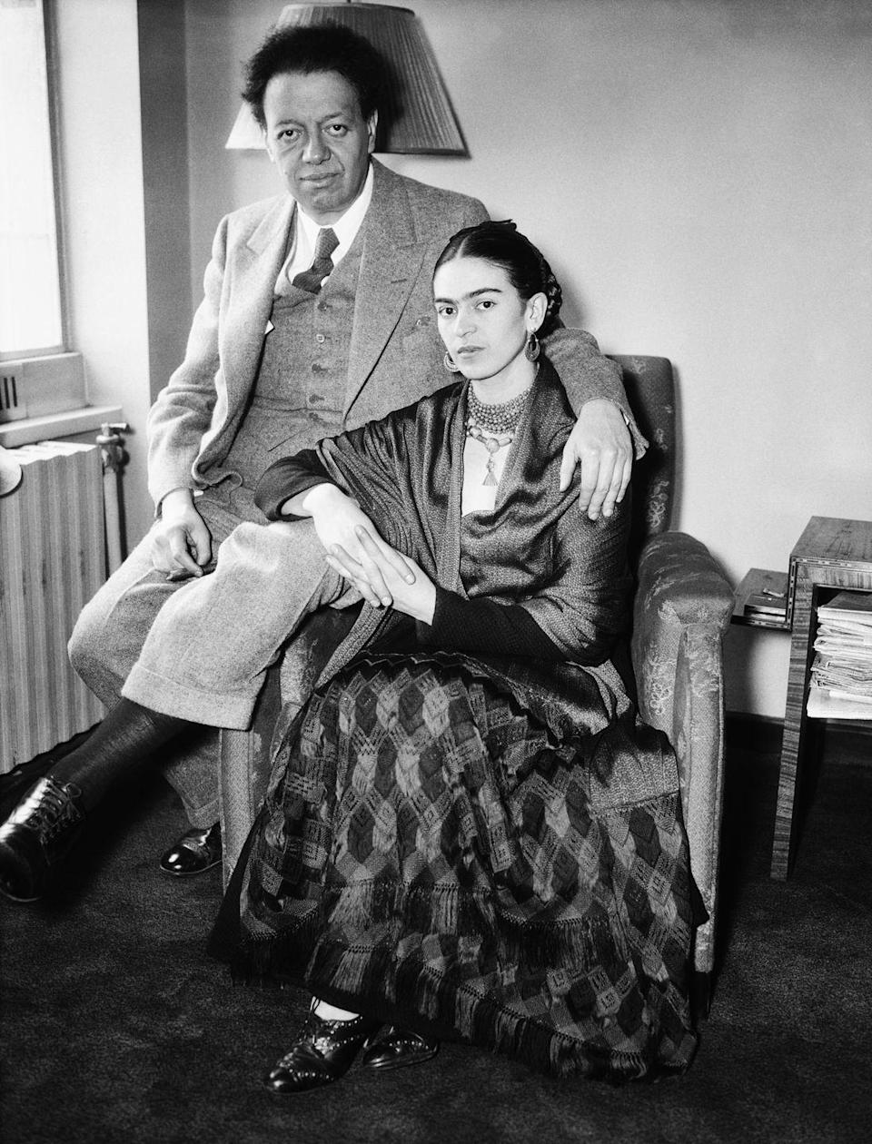 """<p>Renowned Mexican painter Frida Kahlo's marriage to Diego Rivera was known for being complex. The couple, who married for the first time in 1929, <a href=""""https://www.riseart.com/guide/2291/art-world-news-frida-kahlo-and-diego-rivera-romance-and-heartbreak"""" rel=""""nofollow noopener"""" target=""""_blank"""" data-ylk=""""slk:fought constantly and divorced in 1939"""" class=""""link rapid-noclick-resp"""">fought constantly and divorced in 1939</a>. One year after the dissolution of their union, the artists remarried in 1940 and were together until Frida's death in 1954. </p>"""