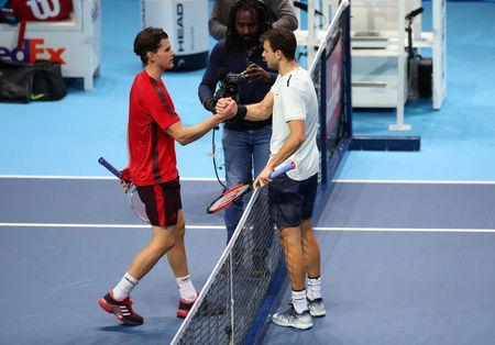 Tennis - ATP World Tour Finals - The O2 Arena, London, Britain - November 13, 2017 Bulgaria's Grigor Dimitrov (R) shakes the hand of Austria's Dominic Thiem after their group stage match REUTERS/Hannah McKay