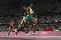 Elaine Thompson-Herah, of Jamaica, wins the final of the women's 200-meters at the 2020 Summer Olympics, Tuesday, Aug. 3, 2021, in Tokyo. (AP Photo/David J. Phillip)