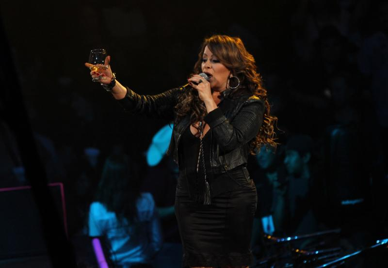 MONTERREY, MEXICO - DECEMBER 08: Mexican singer Jenni Rivera sings during her last concert at the Arena Monterrey on December 08, 2012 in Monterrey, Mexico. Hours after the show the singer was reported missing. The plane where she was traveling with her band crashed on their way to Toluca. (Photo by David Martinez/Clasos.com/LatinContent via Getty Images)