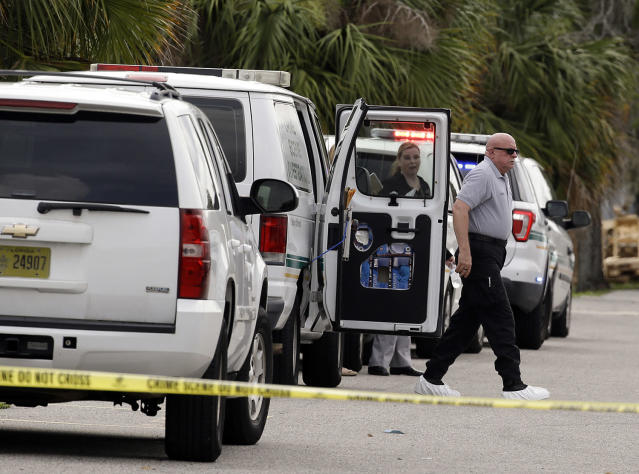 <p>Crime scene investigators prepare to enter the scene of a shooting where there were multiple fatalities in an industrial area near Orlando, Fla., Monday, June 5, 2017. The Orange County Sheriff's Office said on its official Twitter account that the situation has been contained. (AP Photo/John Raoux) </p>
