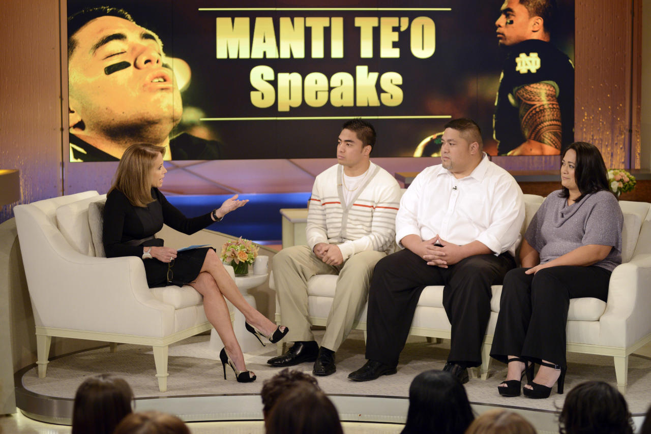 """In this photo taken on Jan. 22, 2013 and released by ABC Notre Dame linebacker Manti Te'o, second from left, and his parents Brian and Ottilia, right, listen to host Katie Couric during an interview for """"Katie,"""" in New York. Te'o told Couric that he briefly lied about his online girlfriend after discovering she didn't exist, while maintaining that he had no part in creating the hoax. The interview will air on Thursday, Jan. 24. (AP Photo/Disney-ABC, Lorenzo Bevilaqua)"""