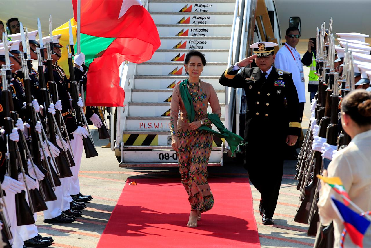 Myanmar State Counsellor Daw Aung San Suu Kyi, reviews honour guards upon arrival at the Manila International airport in Pasay city, metro Manila, Philippines April 28, 2017. REUTERS/Romeo Ranoco