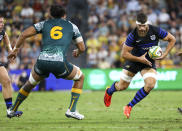 Argentina's Marcos Kremer, right, runs at Australia's Rob Leota during the Rugby Championship test match between the Pumas and the Wallabies in Townsville, Australia, Saturday, Sept. 25, 2021. (AP Photo/Tertius Pickard)
