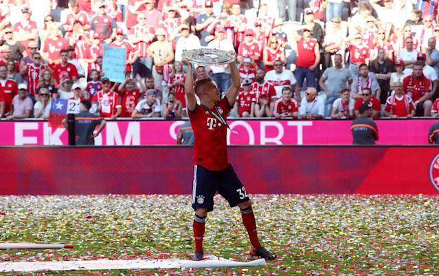 Soccer Football - Bundesliga - Bayern Munich v VfB Stuttgart - Allianz Arena, Munich, Germany - May 12, 2018 Bayern Munich's Joshua Kimmich celebrates winning the Bundesliga with the trophy REUTERS/Michael Dalder DFL RULES TO LIMIT THE ONLINE USAGE DURING MATCH TIME TO 15 PICTURES PER GAME. IMAGE SEQUENCES TO SIMULATE VIDEO IS NOT ALLOWED AT ANY TIME. FOR FURTHER QUERIES PLEASE CONTACT DFL DIRECTLY AT + 49 69 650050