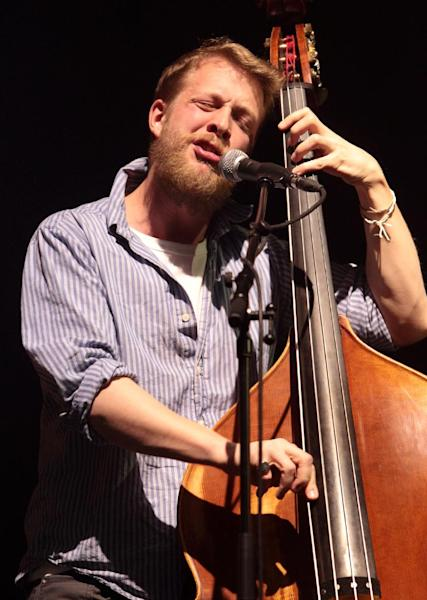 FILE - In this Feb. 16, 2013 file photo, Ted Dwane, of the English folk rock band Mumford & Sons, performs at the Susquehanna Bank Center in Camden, N.J. Mumford & Sons on Thursday, June 13, 2013 announced it has canceled its headlining performance at Bonnaroo Music & Arts Festival in Tennessee. The decision comes after Dwane received treatment this week for a blood clot on his brain. (Photo by Owen Sweeney/Invision/AP, file)