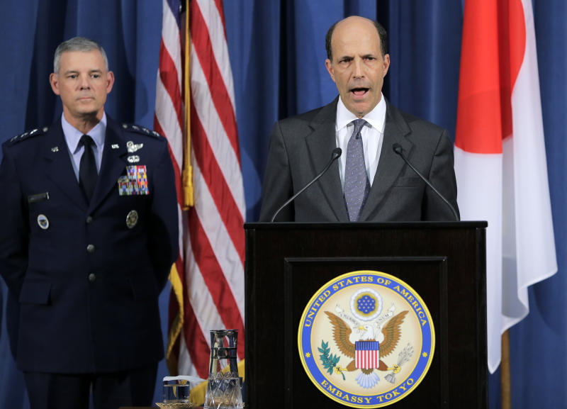 U.S. Ambassador to Japan John Roos, right, delivers to the media as Commander of U.S. Forces in Japan Lt. Gen. Salvatore Angelella listens at the U.S. Embassy in Tokyo, Friday, Oct. 19, 2012. American military personnel will be subject to a curfew and other restrictions following allegations two U.S. sailors raped a woman in Okinawa, the commander of the U.S. forces in Japan said Friday. A statement released by U.S. Forces Japan says the 11 p.m. to 5 a.m. curfew will apply to all U.S. military personnel both stationed and visiting Japan. It requires them to be in their homes, on base or wherever they are lodging. (AP Photo/Itsuo Inouye)