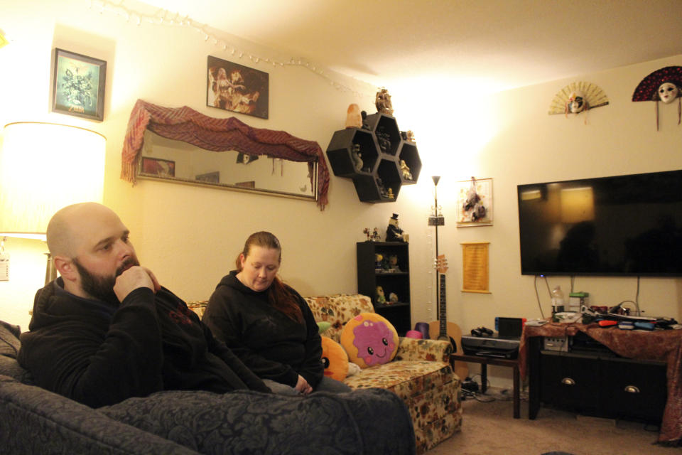 Taylor Wood and her boyfriend, Ryan Bowser, talk about their financial situation inside their Corvallis, Ore., apartment on Dec. 11, 2020. The family is unsure where they will go if an eviction moratorium is not extended and they are kicked out of their home. (AP Photo/Sara Cline)