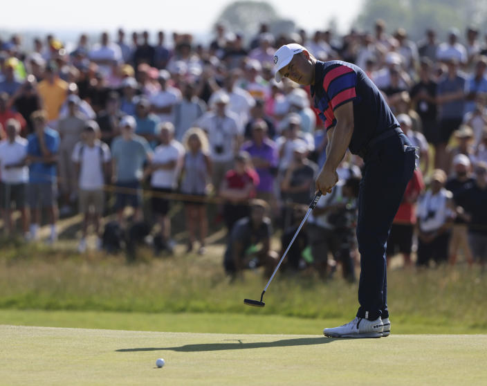 United States' Jordan Spieth putts on the 13th green during the final round of the British Open Golf Championship at Royal St George's golf course Sandwich, England, Sunday, July 18, 2021. (AP Photo/Ian Walton)