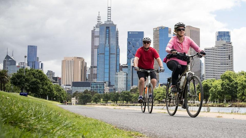 People enjoy riding bicycles along the Yarra River on November 19, 2020 in Melbourne, Australia