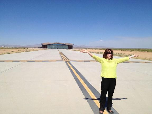 Ready for flight is Christine Anderson, executive director of the New Mexico Spaceport Authority. Virgin Galactic's terminal and hangar facility looms large in the background.